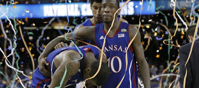 Thomas Robinson, left, is consoled by Tyshawn Taylor, left and Kevin Young, background,after KU's loss to Kentucky in the championship game Monday, April 2, 2012.