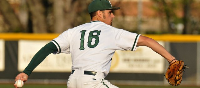 Free State pitcher J.D. Prochaska delivers to Shawnee Mission South on Tuesday, April 3, 2012, at FSHS.