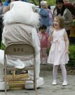 A young girl introduces herself to the Easter Bunny at the Egg Hunt Extravaganza, sponsored by Lawrence Parks and Recreation and Hy-Vee, in South Park on Saturday.