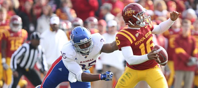 Iowa State quarterback Jared Barnett escapes a sack by Kansas defensive end Toben Opurum during the second quarter on Saturday, Nov. 5, 2011 at Jack Trice Stadium in Ames, Iowa.