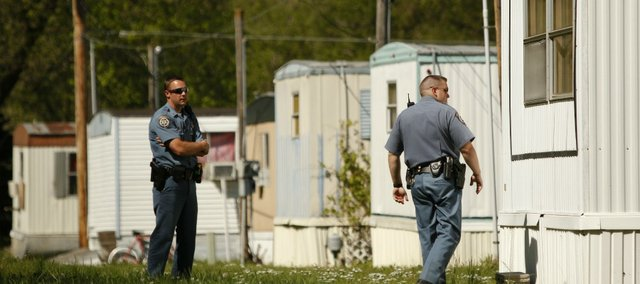 Sheriff's officers walk around a mobile home looking for occupants on Friday, April 6, 2012 at the River View Trailer Park. City inspectors have condemned six of the mobile homes for various code violations.