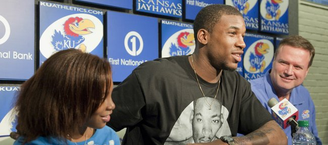 Kansas junior basketball player Thomas Robinson, declares for the NBA Draft on Monday during a press conference with KU coach Bill Self and Robinson's sister Jayla, left.