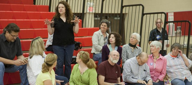 At A Democratic Party caucus at Liberty Memorial Central Middle School on Saturday, Claudean McKellips, area middle school teacher, voices concerns on education funding as why she'd like to be a delegate to attend the Congressional District Convention next month