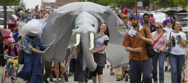 Bicycles, floats, flags, and even elephants march down Massachusetts Street on Saturday during the Earth Day parade. The 12th annual Earth Day Celebration continued in South Park with live music, food vendors and information on ways to recycle, reduce waste and make the world a better place to live.