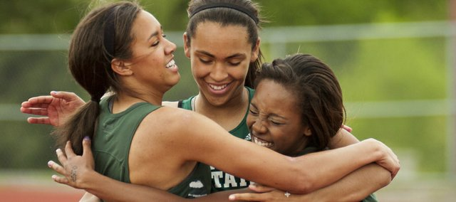 From Left: Free State runners Gabbi Dabney, Alexa Harmon-Thomas and Kiara Clark celebrate after finishing the 100 hurdles at the Firebirds' Barrier Breakers meet on Friday, April 13, 2012, at FSHS.