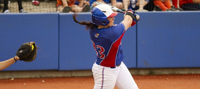 Kansas' Mariah Montgomery misses with a big swing for strike three during KU's game against Texas on Saturday, April 14, 2012, at Arrocha Ballpark