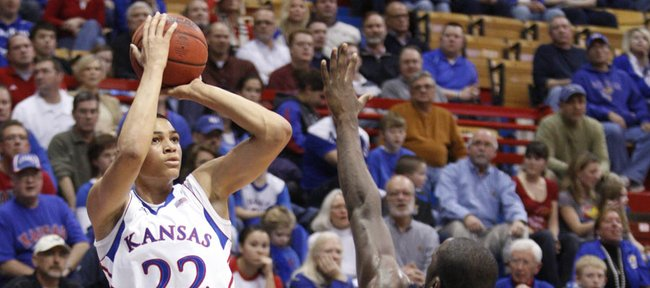 Kansas forward Merv Lindsay puts a shot over Howard forward Theodore Boyomo during the second half on Thursday, Dec. 29, 2011 at Allen Fieldhouse.