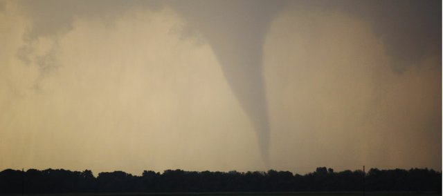 A tornado forms and touches down north of Soloman, Kan., Saturday, April 14, 2012.