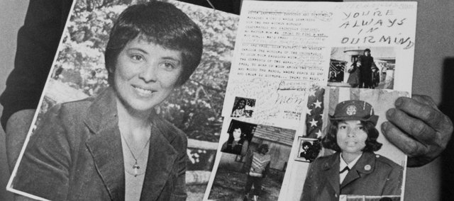 In this file photo from Sept. 12, 1989, Angelina Guadalupe holds photos of her daughter, Nilsa Sanchez, a Lawrence-area mother of two who was found murdered.