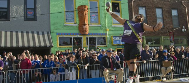 Reese Hoffa of Evans, Ga., tosses one of his shot put throws on his way to a second-place finish in the Kansas Relays Men's Elite Shot Put event in downtown Lawrence on Wednesday, April 20, 2011.