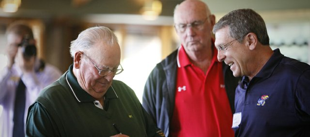 Legendary pro golfer Billy Casper signs an autograph for Gary Leonardi as he meets with Alvamar Country Club members on Wednesday, April 18, 2012. Also pictured in back is Mike Easterday, Lawrence.