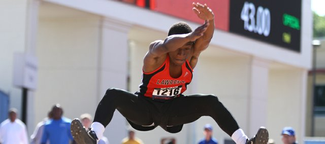 Lawrence High senior Steven Hill comes in for a landing during the Boys Triple Jump Event of the Kansas Relays, Friday, April 20, 2012 at Memorial Stadium.