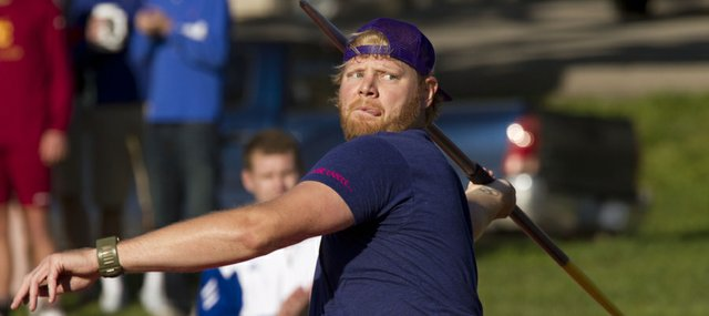 Former Kansas University standout Scott Russell competes in the javelin event at the Kansas Relays Friday, April 20, 2012.