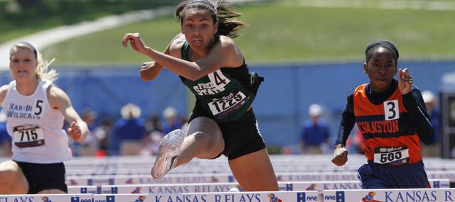 Free State's Alexa Harmon-Thomas clears the last hurdle in the 100 hurdles championship on Saturday, April 21, 2012, at the Kansas Relays at Memorial Stadium.