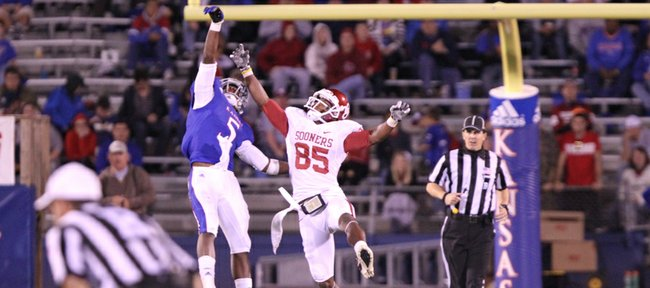 Kansas cornerback Greg Brown tips deep pass away from Oklahoma receiver Ryan Broyles during the third quarter on Saturday, Oct. 15, 2011 at Kivisto Field.