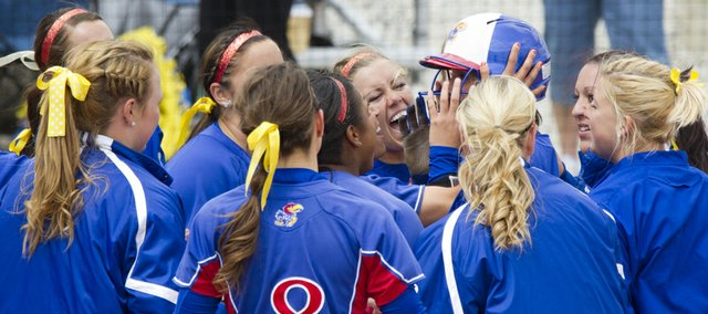 Kansas players gather at home plate to celebrate Maddie Stein's two-run home run during their game against Iowa State on Sunday, April 22, 2012 at Arrocha Ballpark.