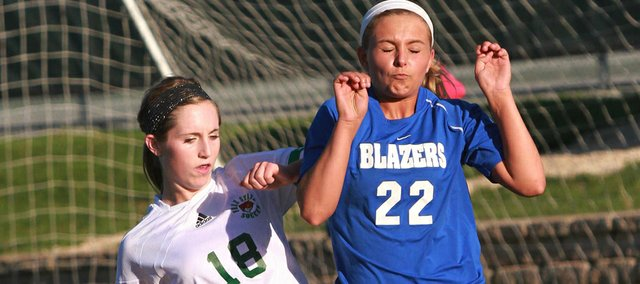 Free State's Hadyn Hutchison and Gardner-Edgerton's Rachael Bovitz fight for a possession on Monday, April 23, 2012, at Free State.