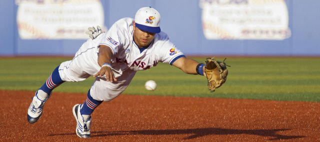 Kansas second baseman Ka'ana Eldredge dives for the ball during Kansas' game against Kansas State Wednesday, April 25, 2012, at Hoglund Ballpark.