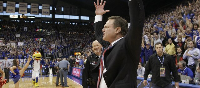 "KU basketball coach Bill Self celebrates an over-time win against Missouri, Feb. 25, 2012. At center, behind Self is KU Public Safety Sgt. Gary Wieden, who has had the job of ""guarding"" Self for the past two years. Self considers Wieden a good luck charm, and the only time Wieden hasn't been guarding Self? A rare home loss to Texas in 2011."
