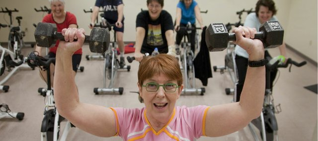 Susan Pomeroy has been a Lawrence Parks and Recreation instructor for nine years. Here, she leads Lawrence residents in dozens of classes involving swimming, Zumba and a recent Friday morning Spin-It bicycling class at the Community Building.