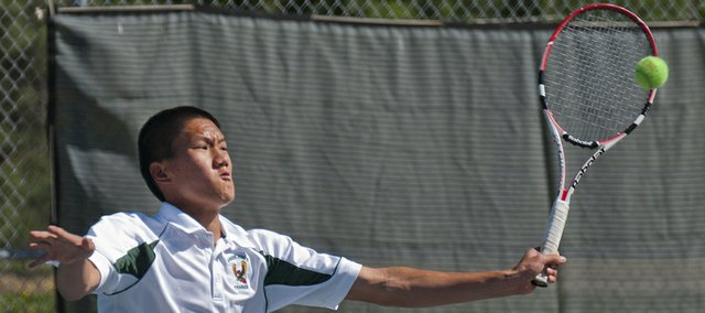 Free State's Richard Lu is quick on the return in doubles play Thursday, April 26, 2012, at the Sunflower League boys tennis invitational at the Indian Creek Recreation Center in Overland Park.