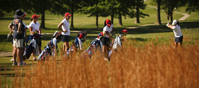Members of the Kansas University women's golf team wait to tee off during a practice round for the Big 12 Championships on Thursday, April 26, 2012, at Lawrence Country Club.