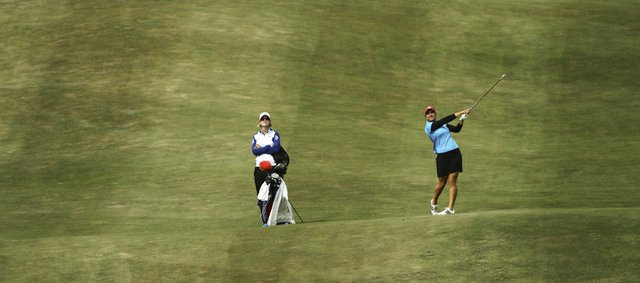 Kansas University golfer Gabriella DiMarco watches her shot on the 14th hole on the opening day of the Women's Big 12 Golf Championship, Friday, April 27, 2012, at Lawrence Country Club.