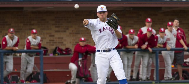 Kansas third baseman Zac Elgie makes a throw to first during Kansas' game against Oklahoma Friday, April 27, 2012, at Hoglund Ballpark.