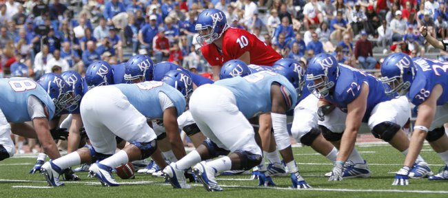Kansas quarterback Dayne Crist gets set for a play during the first half of the Spring Game on Saturday, April 28, 2012 at Kivisto Field.