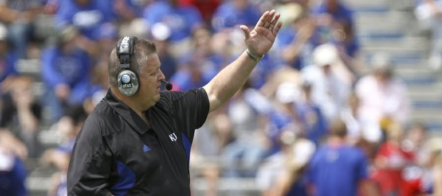 Kansas head coach Charlie Weis calls a play during the first half of the Spring Game on Saturday, April 28, 2012 at Kivisto Field.