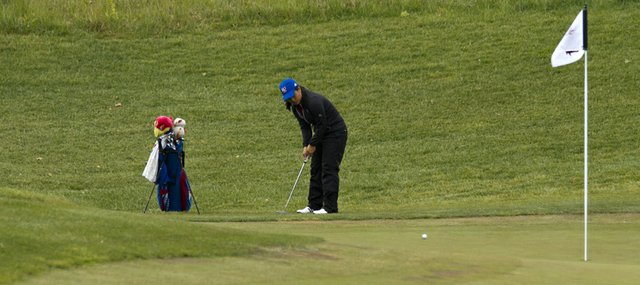 Kansas' Thanuttra Boonraksasat putts on hole six during day two of the Women's Big 12 Championship Golf Tournament Saturday, April 28, 2012 at the Lawrence Country Club.