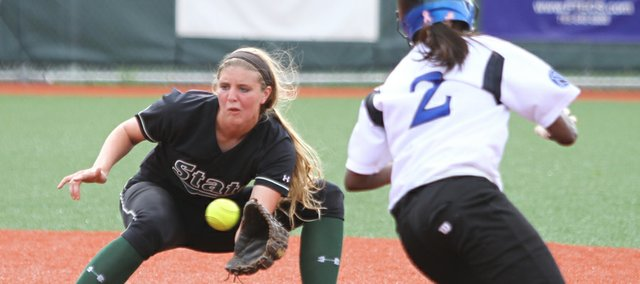 Free State shortstop Samantha O&#39;Brien waits for the throw before tagging out Olathe Northwest runner Vashti Neal during the third inning on Tuesday, May 1, 2012 at Free State High School.