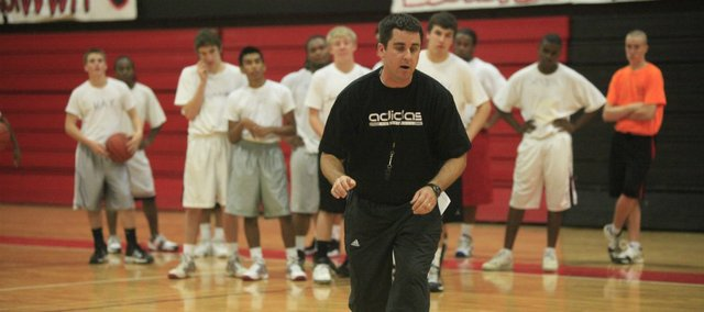 Mike Lewis, head basketball coach at Lawrence High School, works out with players in this 2009 file photo. Lewis resigned as the school's girls' golf coach this week, citing the desire to spend more time with his family.