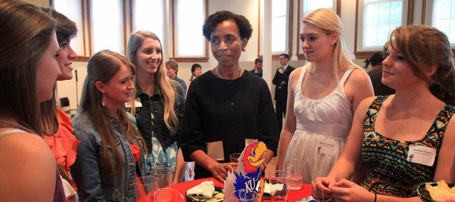 Kansas University Chancellor Bernadette Gray-Little, center, hosted a reception for outstanding Lawrence students on Thursday at Spooner Hall, encouraging them to enroll at their hometown university.