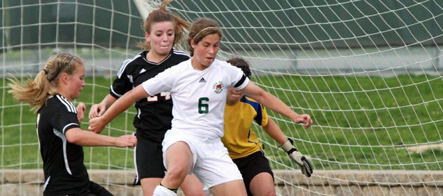 Free State&#39;s Jessica Ferguson (6) looks for a shot against Lions defenders Lauren Fleming, left, and Abby Wilson on Thursday May 3, 2012, at FSHS.