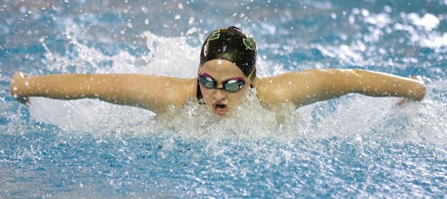 Free State's Kate McCurdy competes in the 200 yard medley relay during the girl's 2012 Sunflower League Championship preliminaries Friday, May 4, 2012 at Lawrence Indoor Aquatic Center.