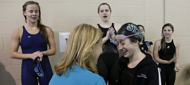 Free State freshman Courtney Caldwell is congratulated by coach Annette McDonald after being announced as the winner of the Girls 100 Yard Freestyle event of the Sunflower League Swimming and Diving Championships on Saturday, May 5, 2012 at Free State High School.