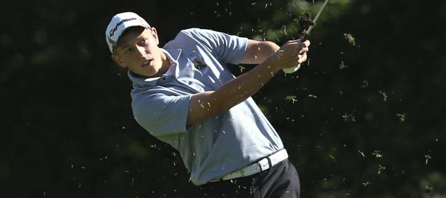 Free State's Alex Green watches a shot from the fairway on the fifth hole, Wednesday, May 9, 2012 at Alvamar Golf Course.
