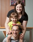 Kansas University doctoral candidate Annalise Nawrocki is pictured with her two-year-old daughter, Zoie Nawrocki, and husband Cory Hills on Thursday in their Lawrence home. Nawrocki and Hills experienced an unforeseen difficulty when Hills suffered a brain hemorrhage after a fall from a ladder. While helping her husband through his recovery and raising their daughter, Nawrocki managed to continue with her doctoral degree in ecology and evolutionary biology.