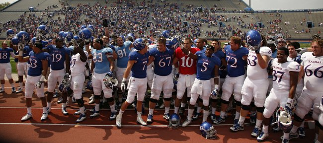The Jayhawks sing the Alma Mater before the band and the student section following the Spring Game on Saturday, April 28, 2012 at Kivisto Field.