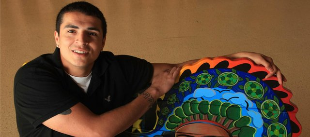 Graduating Haskell senior Eddie Moore, who grew up on the impoverished Fort Belknap Reservation in Montana, is the first person in his family to get a bachelor's degree. He has lined up an internship with the corporate headquarters of Wal-Mart Stores Inc. in Arkansas.