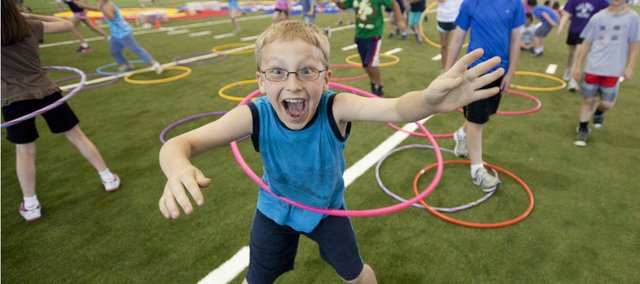 A third-grader acknowledges the camera with excitement during the recent Kansas Kids Fitness and Safety Day at Anschutz Pavillion.