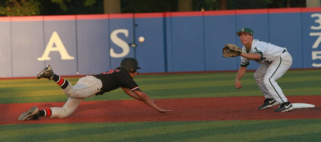Free State shortstop Anthony Miele makes the pickoff on Lawrence High courtesy runner Erick Mayo in the fourth inning of the city showdown on Thursday, May 10, 2012, at Hoglund Ballpark on the Kansas University campus.