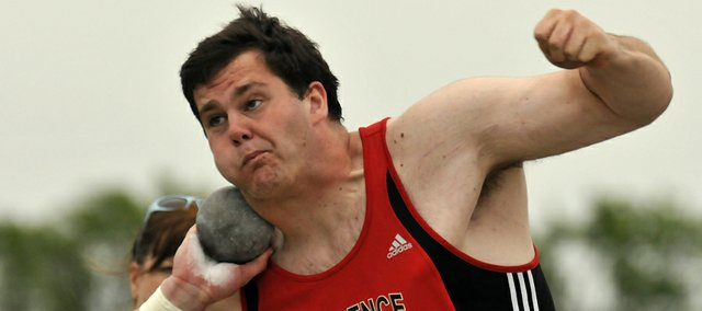 Lawrence High's Blake Hocking spins in the Sunflower League shot put competition on Friday, May 11, 2012, at the Olathe District Activity Center. Hocking claimed his second straight Sunflower League title in the event.