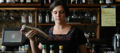 Bartender Katie Wade says part of her job at 715 restaurant is inventing new drinks.