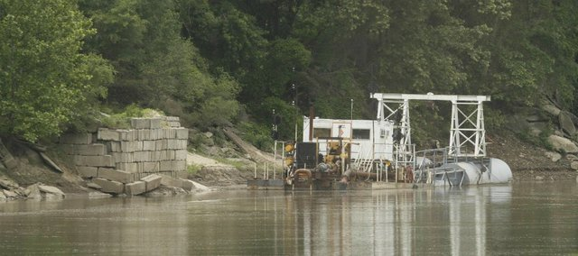 A dredging operation sits east of downtown Lawrence along the Kansas River. Environmentalists say proposals to expand dredging of the river would degrade the river bed and bank, as well as stir up pollutants that have settled at the bottom of the river.
