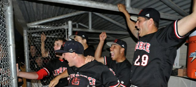 The Lawrence High dugout erupts in jubilation after the final strike to seal a victory against Olathe Northwest in the Class 6A regional championship game on Tuesday, May 15, 2012, at CBAC in Olathe.