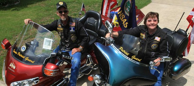Richard Gwin/Journal World-Photo.From Left Bill Cassity and his wife Nancy Cassity, sit on their motorcycles on Friday May 18, 2012, they will be riding to Washington D.C. as part of the Run for the Wall, a honoring of vets.