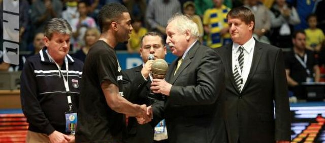 Former Kansas University basketball player Keith Langford, second from left, accepts the hardware as MVP of the Adriatic League's Final Four tournament.
