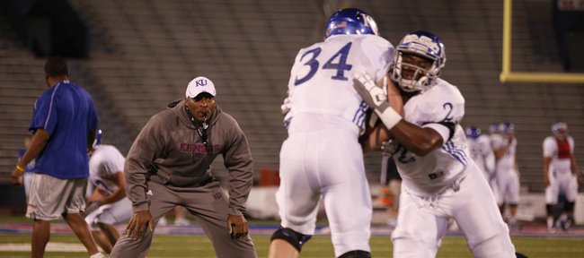 Kansas linebackers coach DeMontie Cross watches over drills during a morning practice on Thursday, April 19, 2012 at Memorial Stadium.